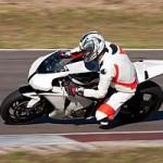 Motorbike racing on the track.