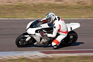 Motorbike racing on the track.