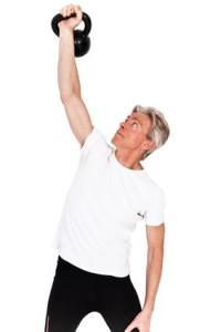 man lifts weights