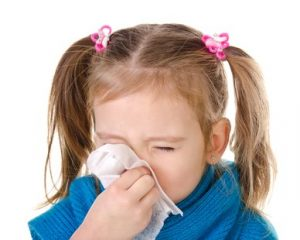 should you get the flu shot this year little girl sneezing